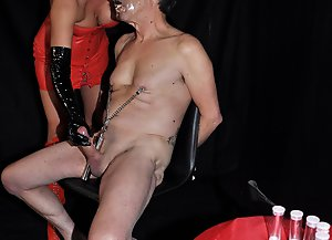 Dominatrix Carly makes her slave produce some hot cum and then pours it down his throat.