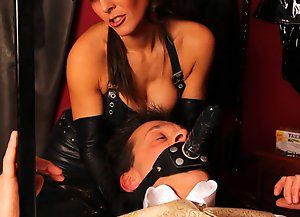 Mistress Lola and Dominatrix Annabelle continue to torment Hobson as hes strapped to the bench