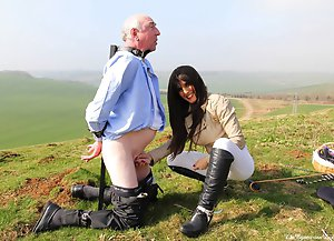Lady Annabelle leads her human pony to one of her paddocks and rides and spanks him