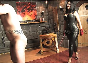 A strong slave is whipped by a black haired bombshell