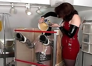 Rubber Ponies 02 - Mistress Amanda's rubber pony has failed to perform adequately and the punishment follows immediately as he gets stretched in