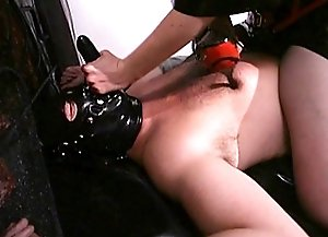 Mistress Aradia toy-teasing and caging her submissive male slave