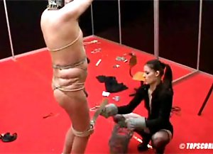 Slave getting his body wrapped in barb wire