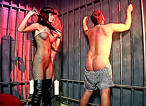 Mistress in top boots and sexy body stocking spanks and whips her chubby male slave's ass with great pleasure