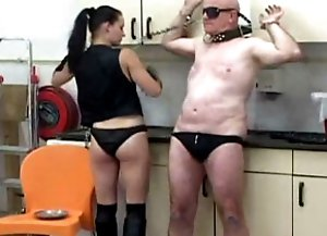 Slave getting his legs chained by his mistress