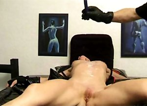 Masked slave getting punished with hot candle wax