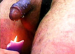 BDSM hostess has gone so wild that not only whipping his cock but also slaking candle with his jizz