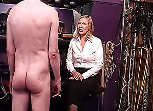 Domme's favorite slave spreads his buttocks to get his ass, cock and balls spanked and caned with no mercy