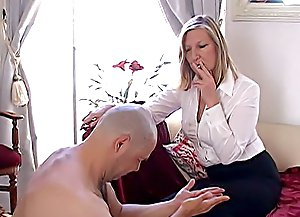 Mature mistress gets her slave strapped, spanks his ass red and canes his tender buttocks making him moan of pain