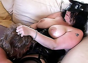 A good portion of flogging by two cross-dressed transvestites does good to the poor sissy making him swallow penis balls deep