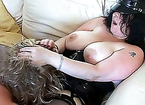 Busty seductress sits down onto the couch, spreads legs and makes submissive buddy lick her pussy on the best crossdressing porn on the net