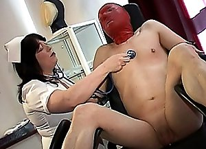 It seems like horny dominant mistress in nurse uniform wants to punish her slave once again. She's tied this man and put a mask on his face. So,