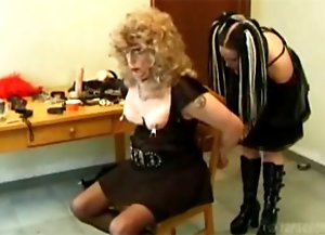 Female dressed slave punished with cigarette