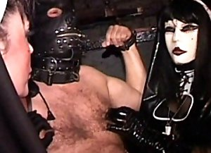 Misstress plays with bound slaves