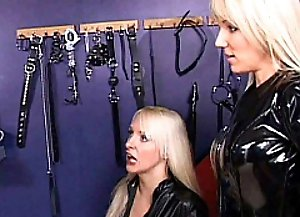 Submissive shemales obeys her Dominas