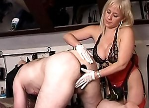 Guy stands doggy style and feels big dildo and huge strap on of luxurious busty blonde mistress in anus.