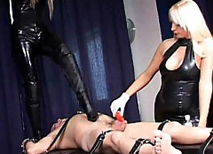 Two Kinky DOminas and a bound male