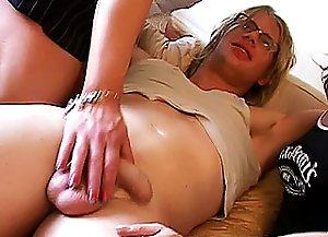 Blond crossdresser reveals his dick and gets it caressed and sucked by other mature crossdressers right on the couch.