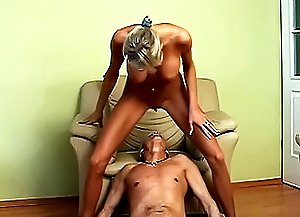 In fits of unbound passion lustful mistresses make slave guy sit down onto the arm-chair. Then one of them tramples old slave's dick. All of them