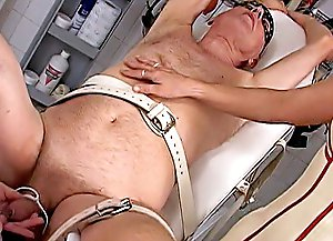 Experienced mistress and a bigtitted latex nurse administer CBT and electric punishments in a hospital Gyno chair